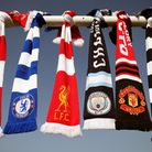 A selection of scarves at Hackney Marshes of six Premier League clubs who planned to join a European Super League