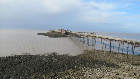 A tranquil Weston seafront and Birnbeck Pier.