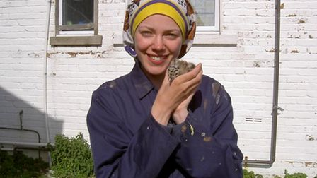 Dr Viola Ross-Smith with a gull chick.