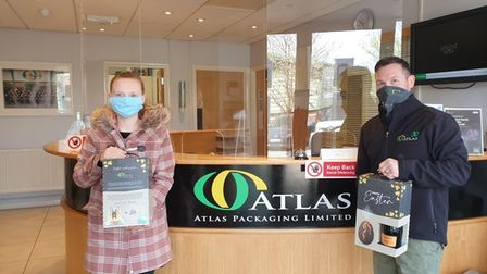 Brooke holds the packaging she inspired along with Atlas Packaging's head of design Dave King