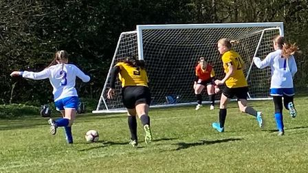 Hitchin Belles Football Club's U12 Redsteam in action