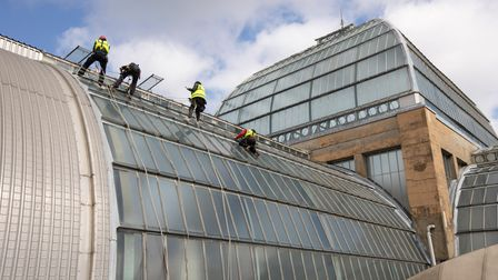 Workers in harnesses had to let themselves down Ally Pally's glass roof to carry out the maintenance work