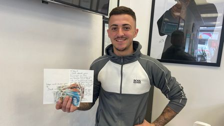 David Cardoso with the envelope and cash.