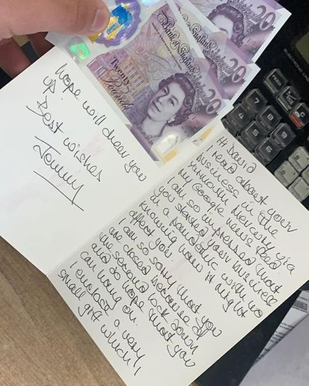 A written-in card and three £20 notes.