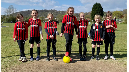 Clevedon United Girls under-eights display their new kit sponsors