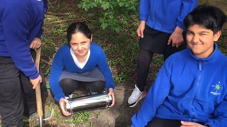children bury a time capsule