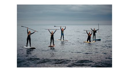 Trying out the new paddle boards and wet suits