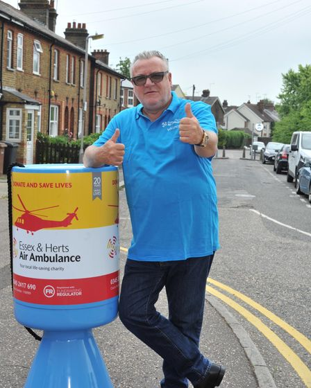 Ray Winstone leans against a giant charity fundraising pot