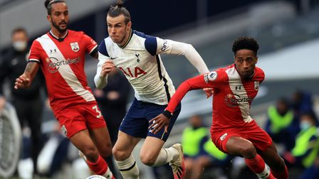 Tottenham Hotspur's Gareth Bale and Southampton's Kyle Walker-Peters (right) battle for the ball