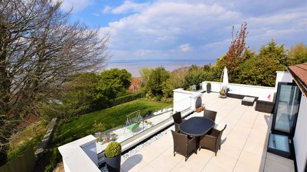 Terrace with table and chairs and garden to left overlooking Redcliffe Bay, Portishead