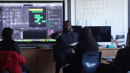 Music teacher OluSodeinde in the classroom at Little Ilford School.