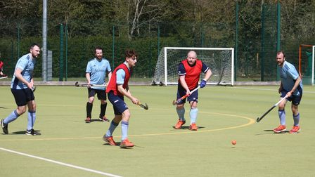 St Neots Hockey Club players Luca and Iain Moore (in bibs) with Ben Seaber