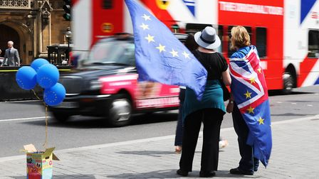Pro EU activists fly flags of the European Union and Great Britain together whilst stood near the Pa