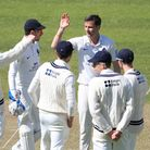 Middlesex's Tim Murtagh (facing) celebrates taking the wicket of Surrey's Jamie Smith