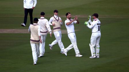 Somerset's Lewis Gregory celebrates with teammates after taking a wicket