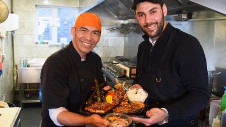 Ali Zandi, right, owner, and Ciscoe, head chef, with their Japanese barbecue food newly launched at