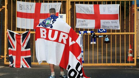 File photo dated 27/08//19 of a Bury fan at the gates of Gigg Lane, Bury. Phil Young, the chairman o