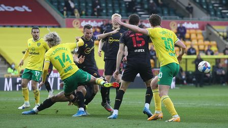 Todd Cantwell of Norwich and Kieran Dowell of Norwich in action against Watford