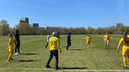 Mayor of London Sadiq Khan having a kickabout with young Hackney Wick FC players.
