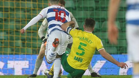 Grant Hanley of Norwich makes a last ditch tackle to deny Ilias Chair of Queens Park Rangers during