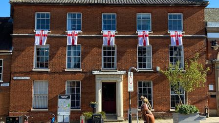 Businesses in Wymondham put up red and white flags to mark St George's Day 2021.