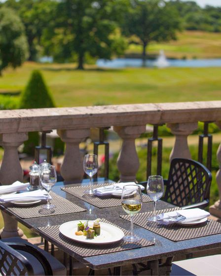 The terrace at Hanbury Manor, Ware, Hertfordshire, with views across the championship golf course