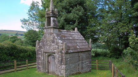 Dupath Well looks like a grey stone, small chapel with a short steeple and a wooden door.
