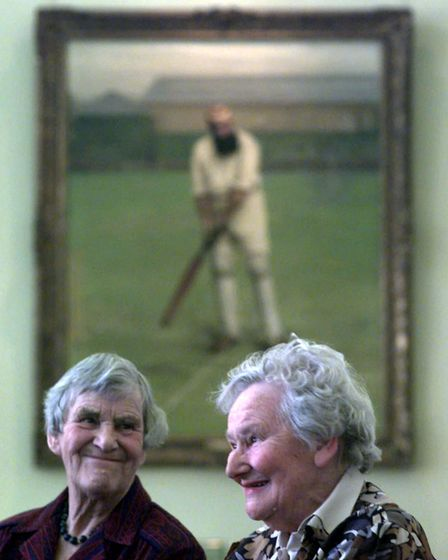 Audrey Collins (left) with Diana Rait Kerr in the Long Room at Lords in front of a portrait of WG Grace