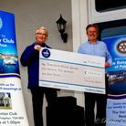 Martin Brook from THHNaccepting a cheque from Mike Kirkham,president of the Rotary Club of Paignton