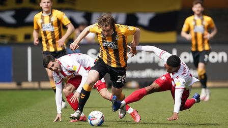 Cambridge United's Joe Ironside (centre) evades a tackle from Stevenage's Terence Vancooten (right)