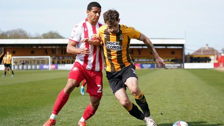 Stevenage's Luther Wildin (left) and Cambridge United's Jack Iredale battle for the ball during the