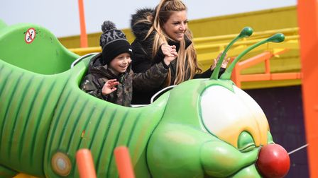 Amy Inch and with her son, Marley, six, enjoying the caterpillar ride as the Pleasure Beach opens to