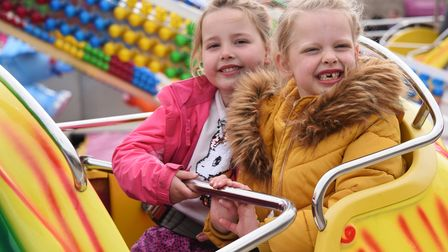Emily Thacker, left, and her cousin, Isabelle Harmer, both aged six, on the Dumbo ride as the Pleasu
