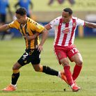 Cambridge United's Kyle Knoyle (left) and Stevenage's Elliott List in action