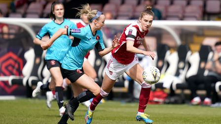 Arsenal's Vivianne Miedema (right) and Gillingham's Georgia Pearch battle for the ball