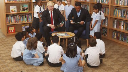 Boris Johnson (left) joins Peter Andre to read to children at Botwell Green Library, London while he