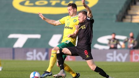 Kenny McLean of Norwich and Tom Cleverley of Watford in action during the Sky Bet Championship match