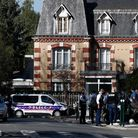 Police officers gather next to the Police station in Rambouillet.