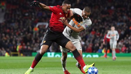 Manchester United's Anthony Martial (left) and BSC Young Boys' Mohamed Ali Camara battle for the bal