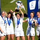 England's Saracens players celebrate with the trophy