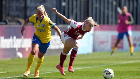 Arsenal's Beth Mead (right) and Brighton and Hove Albion's Emma Koivisto battle for the ball during