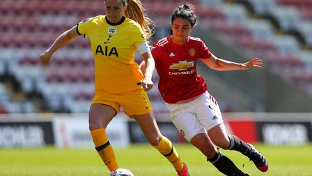 Tottenham Hotspur's Shelina Zadorsky (left) and Manchester United's Jess Sigsworth battle for the ba