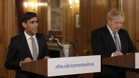 Chancellor Rishi Sunak with Prime Minister Boris Johnson at a media briefing in Downing Street, Lond