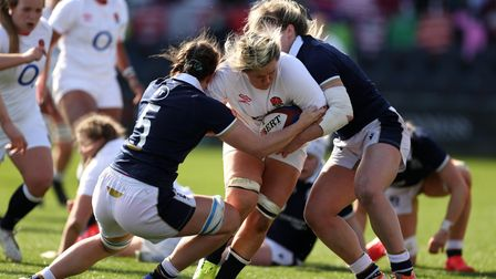 England's Bryony Cleall is tackled by Scotland's Louise McMillan (left) during the Women's Guinness