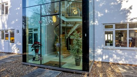 Theglass entrance is a stand-out feature of the property.