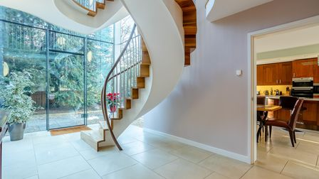 The front door opens to this striking Bisca staircase.