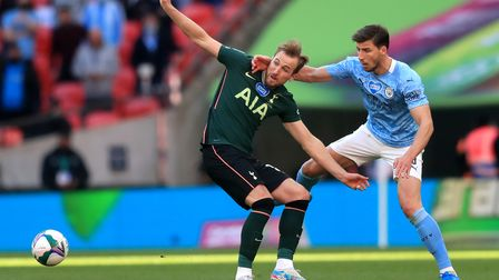 Tottenham Hotspur's Harry Kane (left) and Manchester City's Ruben Dias battle for the ball during th