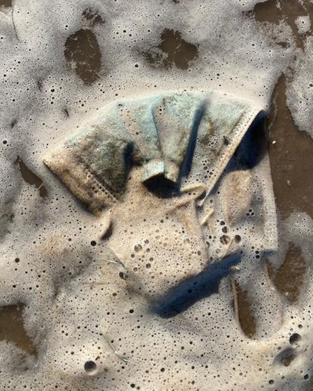 Dozens of face masks swept into the sea after sunny weekend.