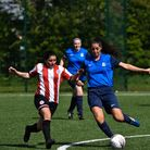 Clapton CFC's Maria Mendonca challenges for the ball