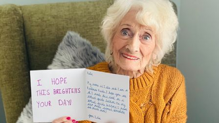 Sylvia, a resident at Prince George House care home in Ipswich, with a card from a member of 1st Rushmere Guides